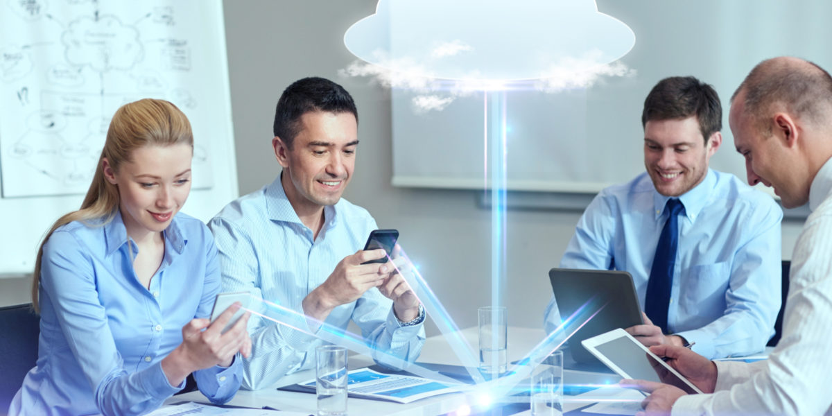 Office workers looking at phones while cloud floats above them